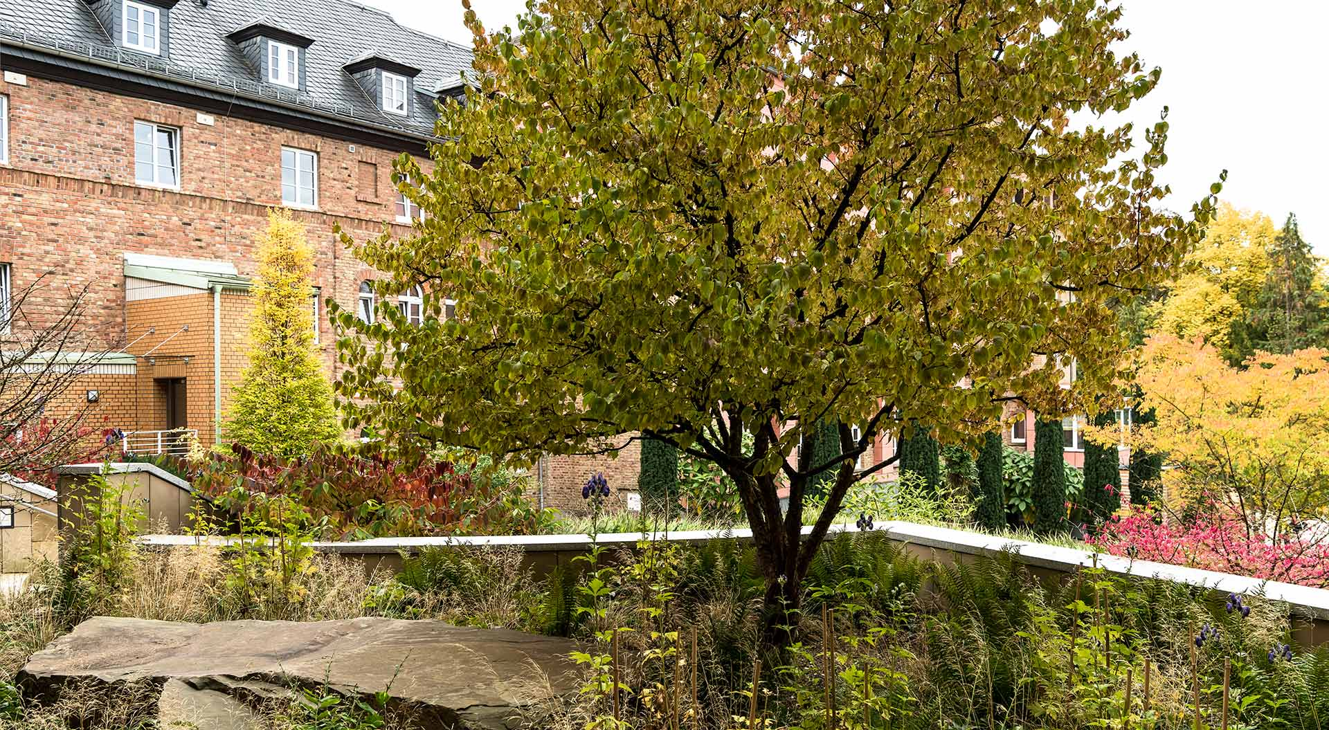 Monastery building blends perfectly into the landscaped garden