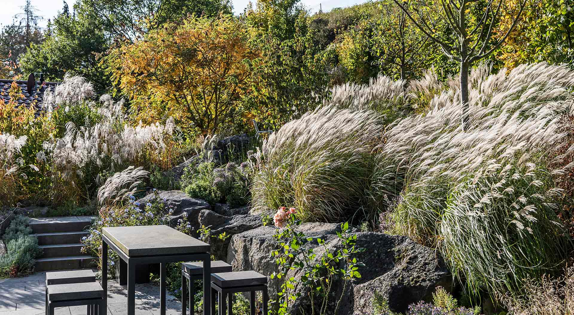 Seating on terrace between natural stones and bushes